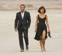 James Bond (DANIEL CRAIG) and Camille (OLGA KURYLENKO) walk through the Bolivian desert.