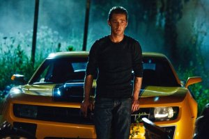 Shia LaBeouf as Sam Witwicky with his trusty Transformer Bumblebee looking like a 2010 Camaro