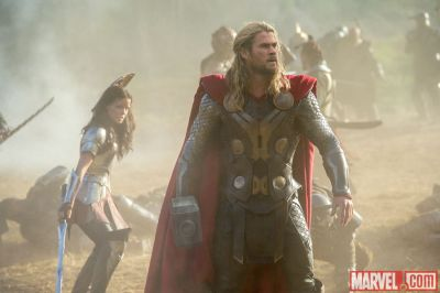 Thor (Chris Hemsworth) and Sif (Jaimie Alexander) on the battlefield in Marvel's Thor: The Dark World. Photo © 2013 Marvel